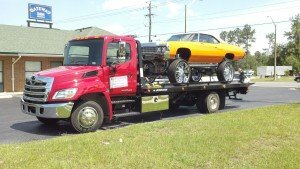 Towing Services Lake City Bryant's towing an Impala Donk