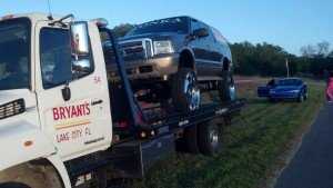Bryant's towing an SUV with HUGE rims a long distance!